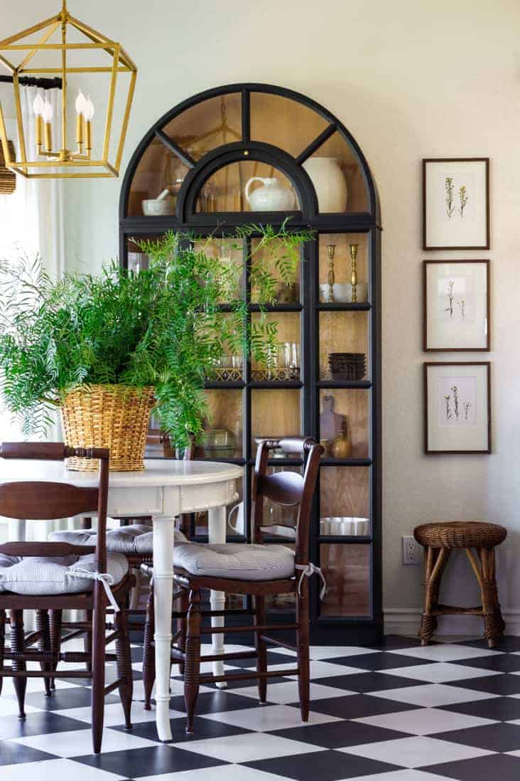 breakfast nook with glass cabinet and harlequin floors