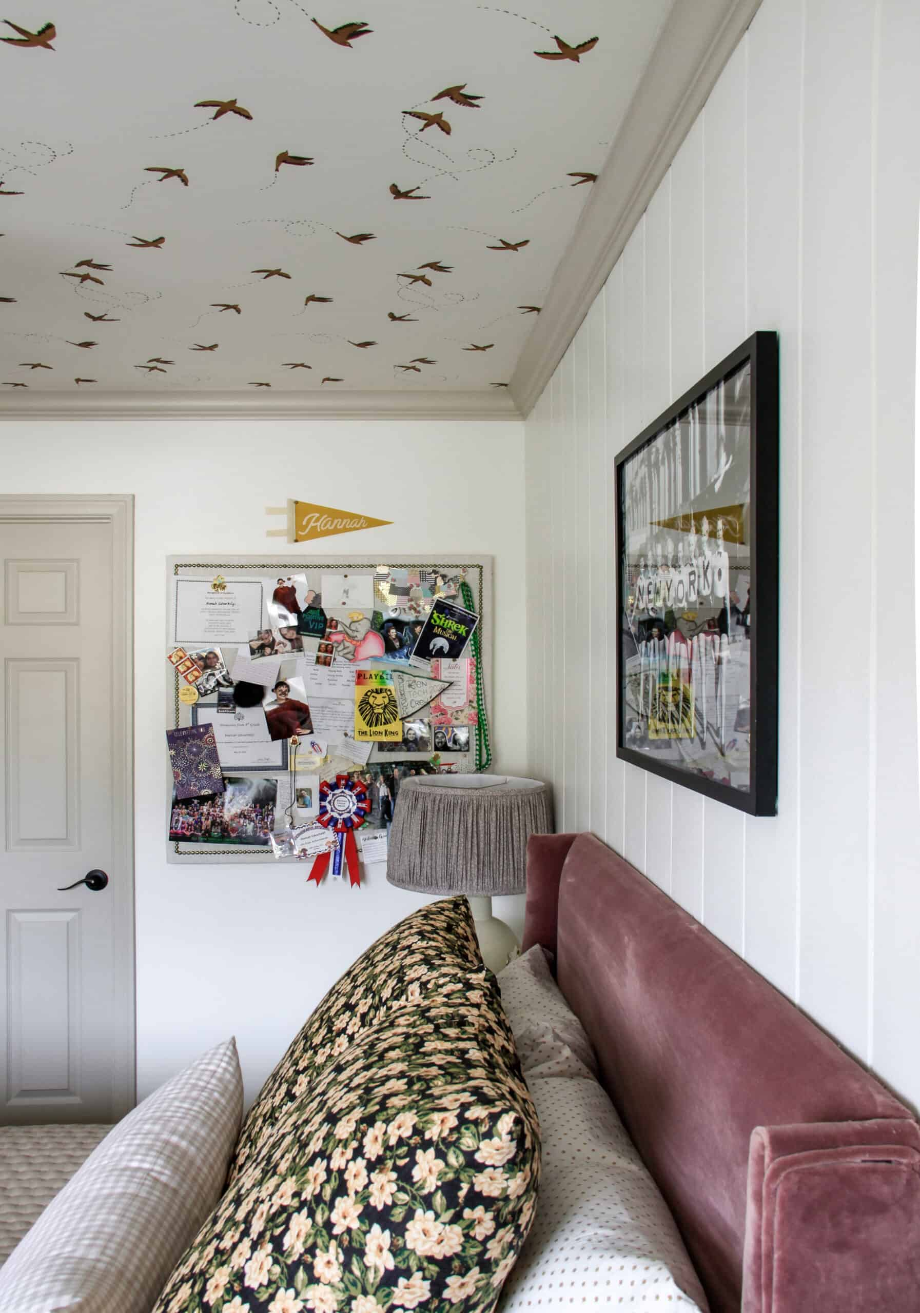 bulletin board full of photos in girl's english cottage nyc apartment style bedroom
