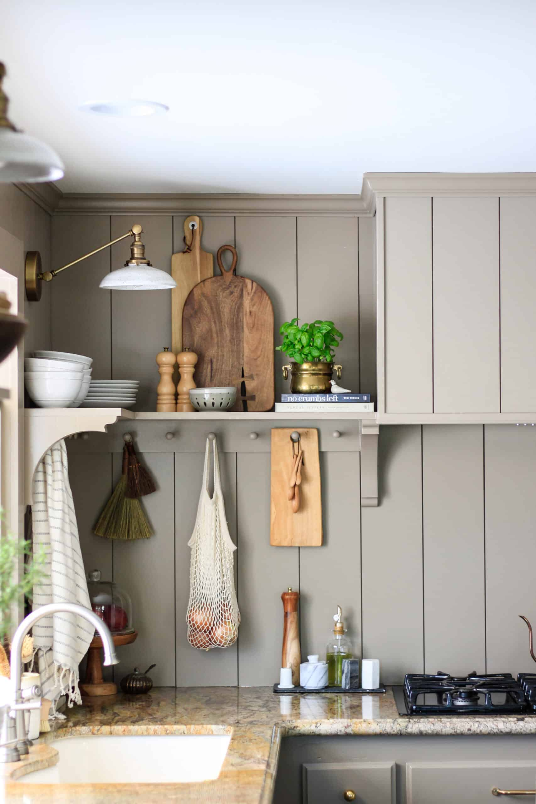 taupe shiplap kitchen hood and shelf
