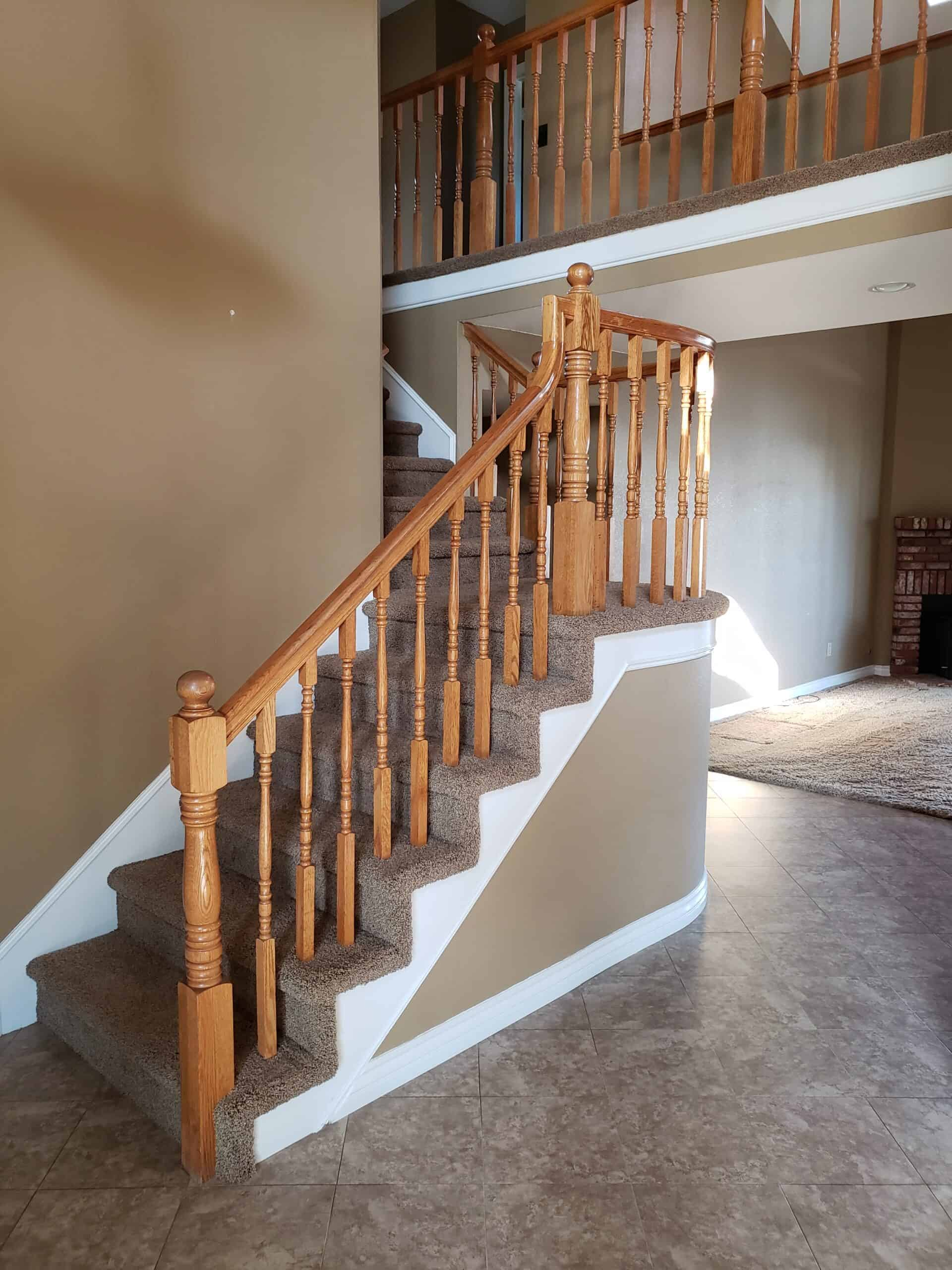 before picture of staircase with brown banister