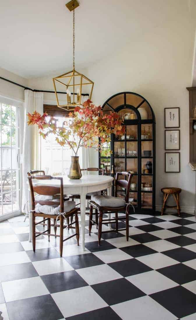 breakfast nook with black and white floors