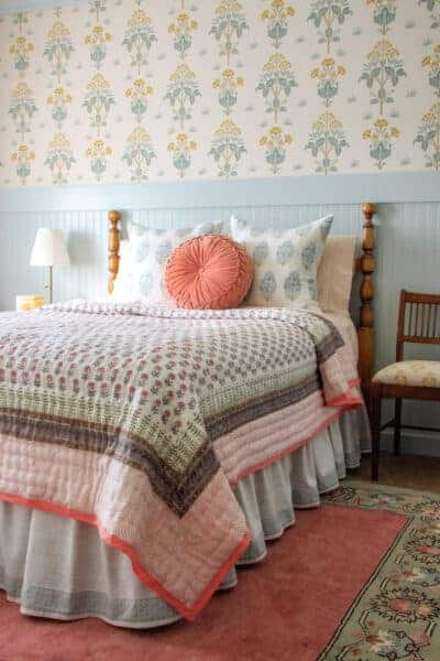 girls bedroom with quilt on bed