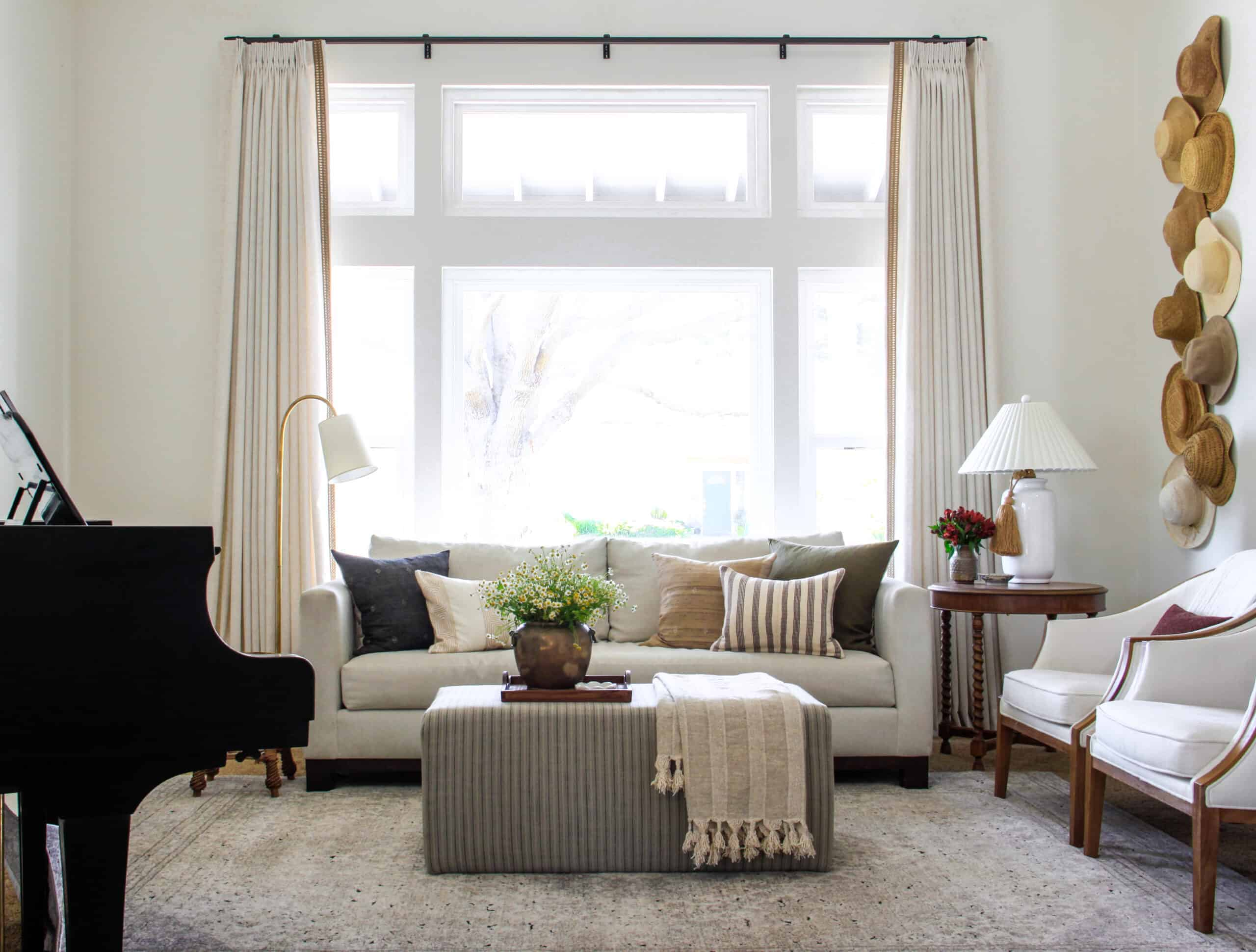 formal living room with motorized drapes
