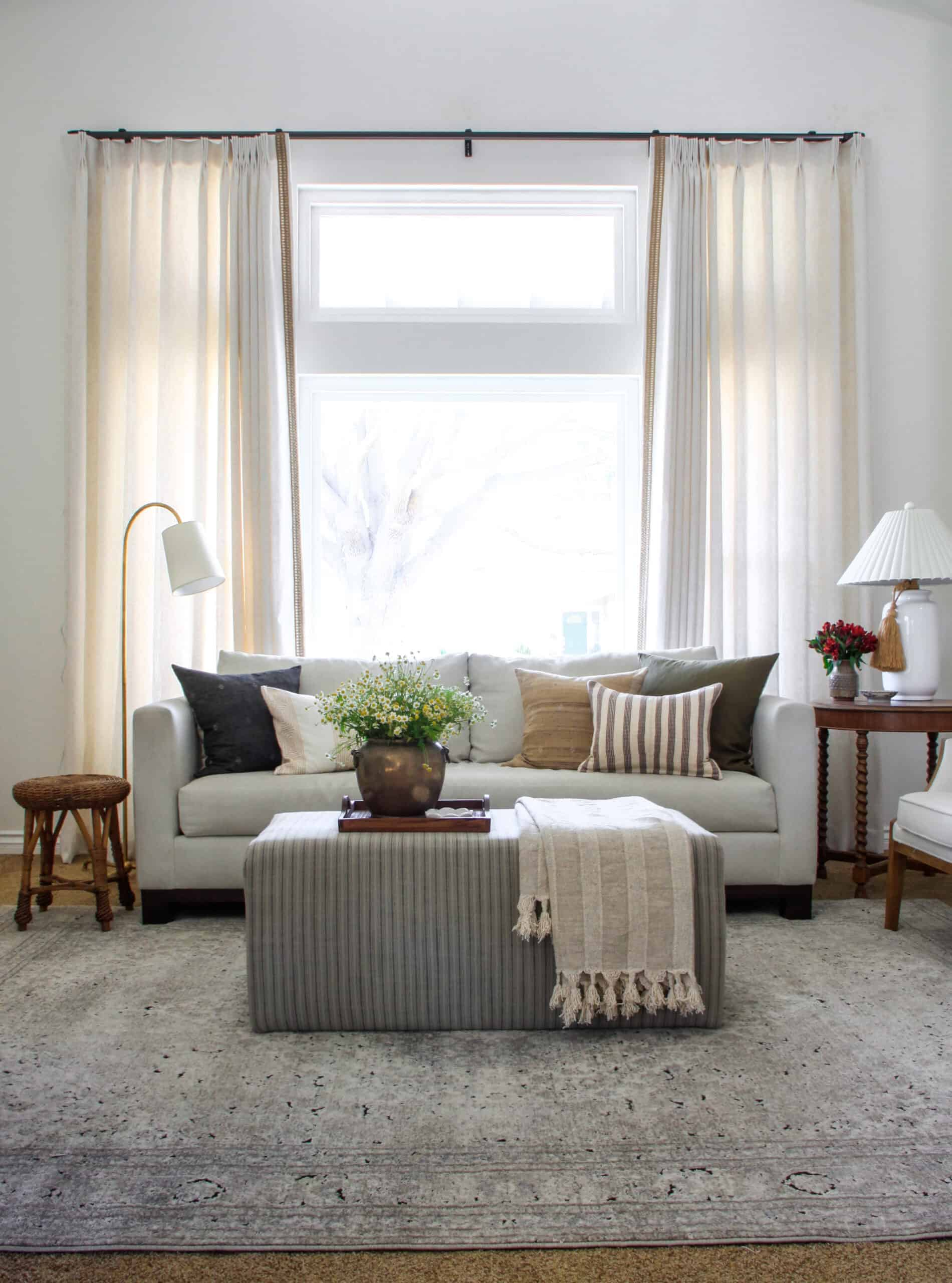 formal living room with motorized curtains