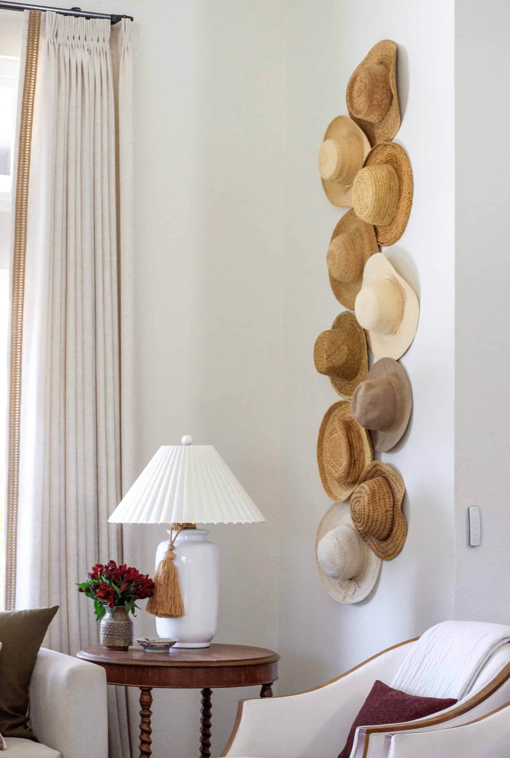 corner of living room with straw hats and motorized curtains