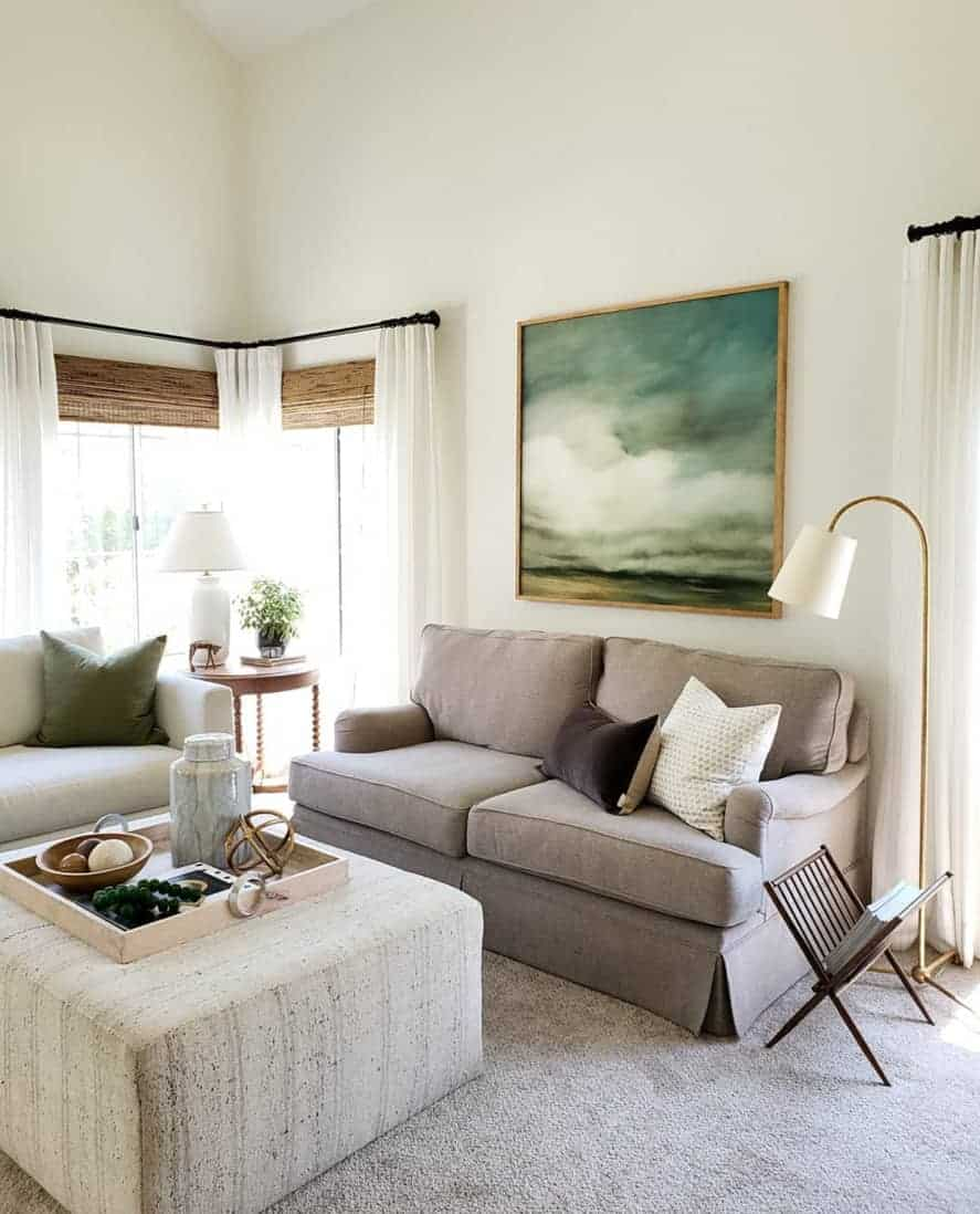 living room with upholstered block ottoman