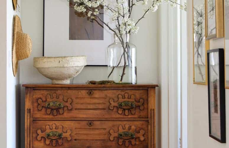 Antique chest with flower branches styled on top