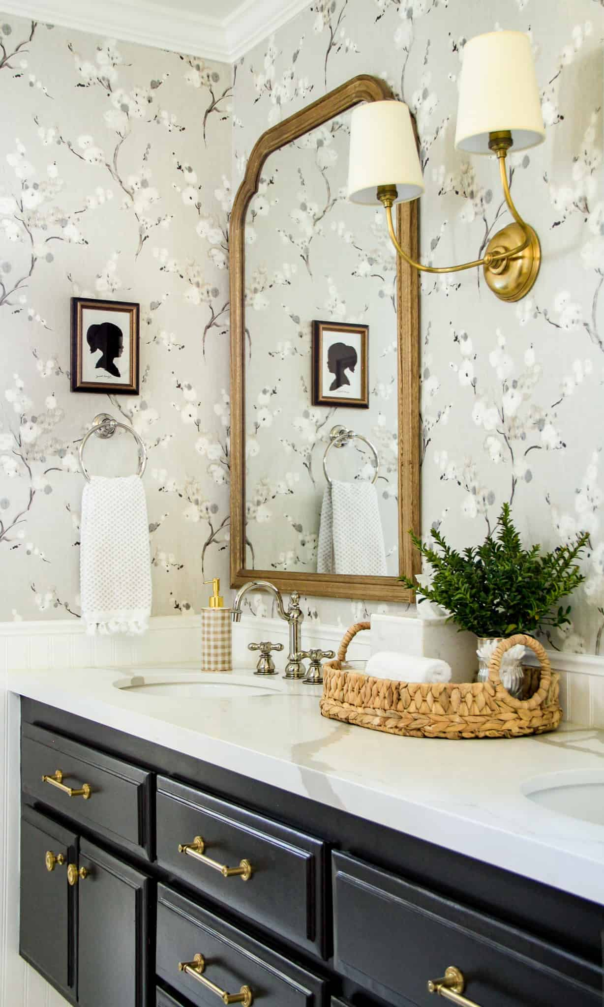 gray and white bathroom with floral wallpaper
