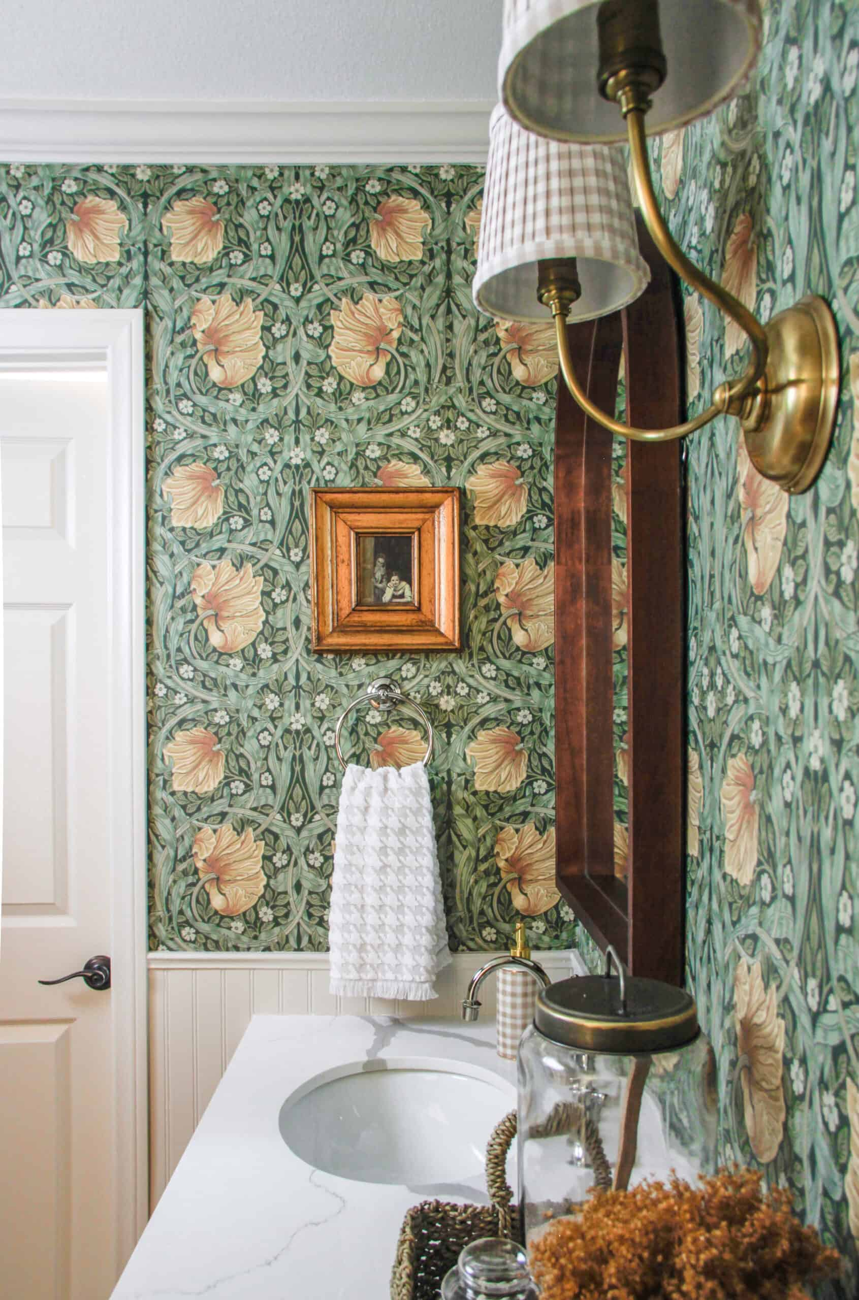 side view of storybook style bathroom with vintage gold frame