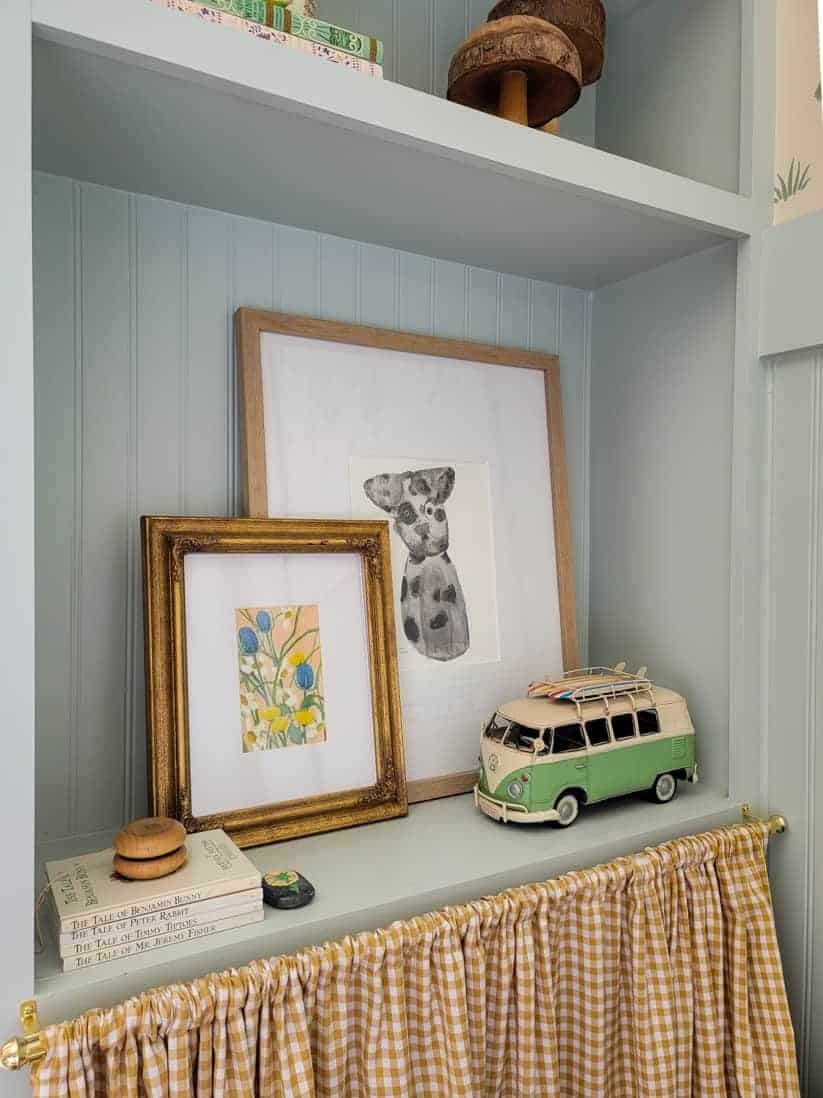 light blue built ins with layered art and VW van toy