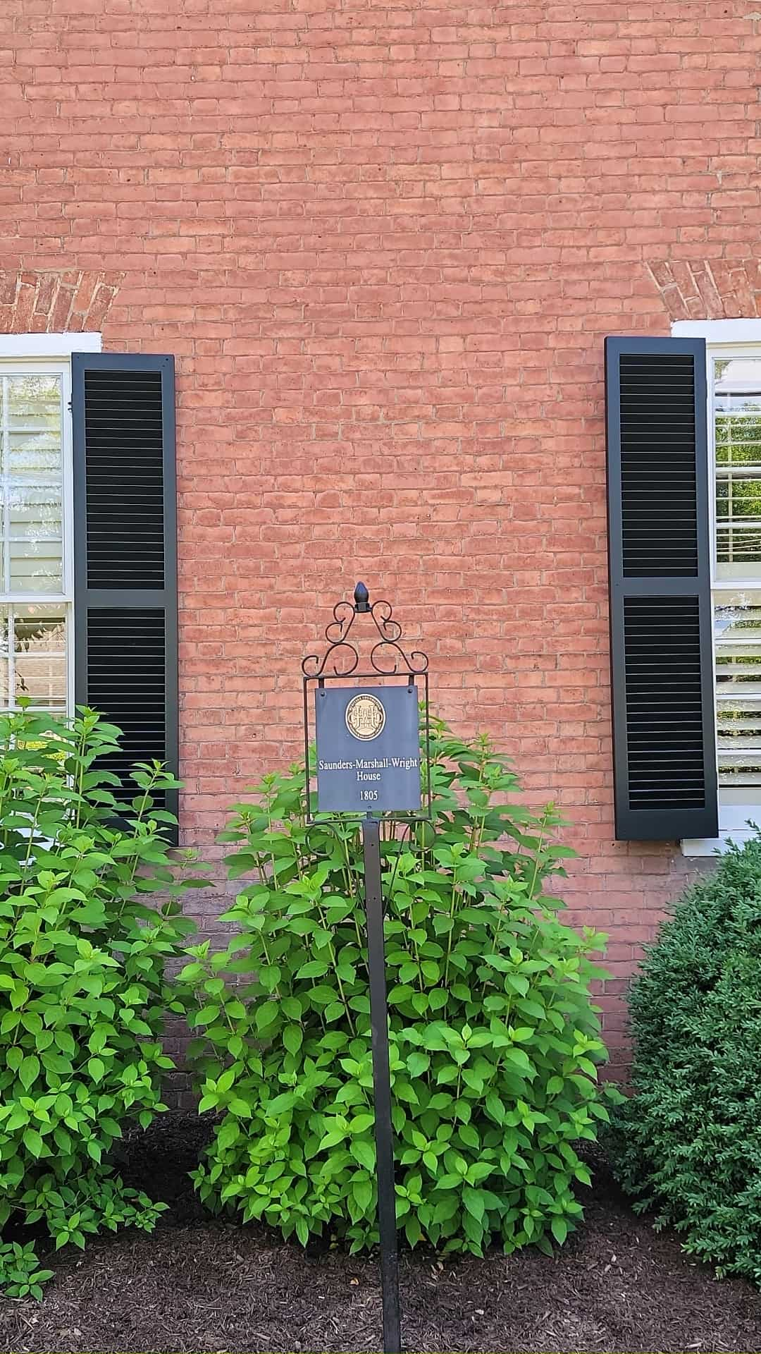 historic home with plaque in front