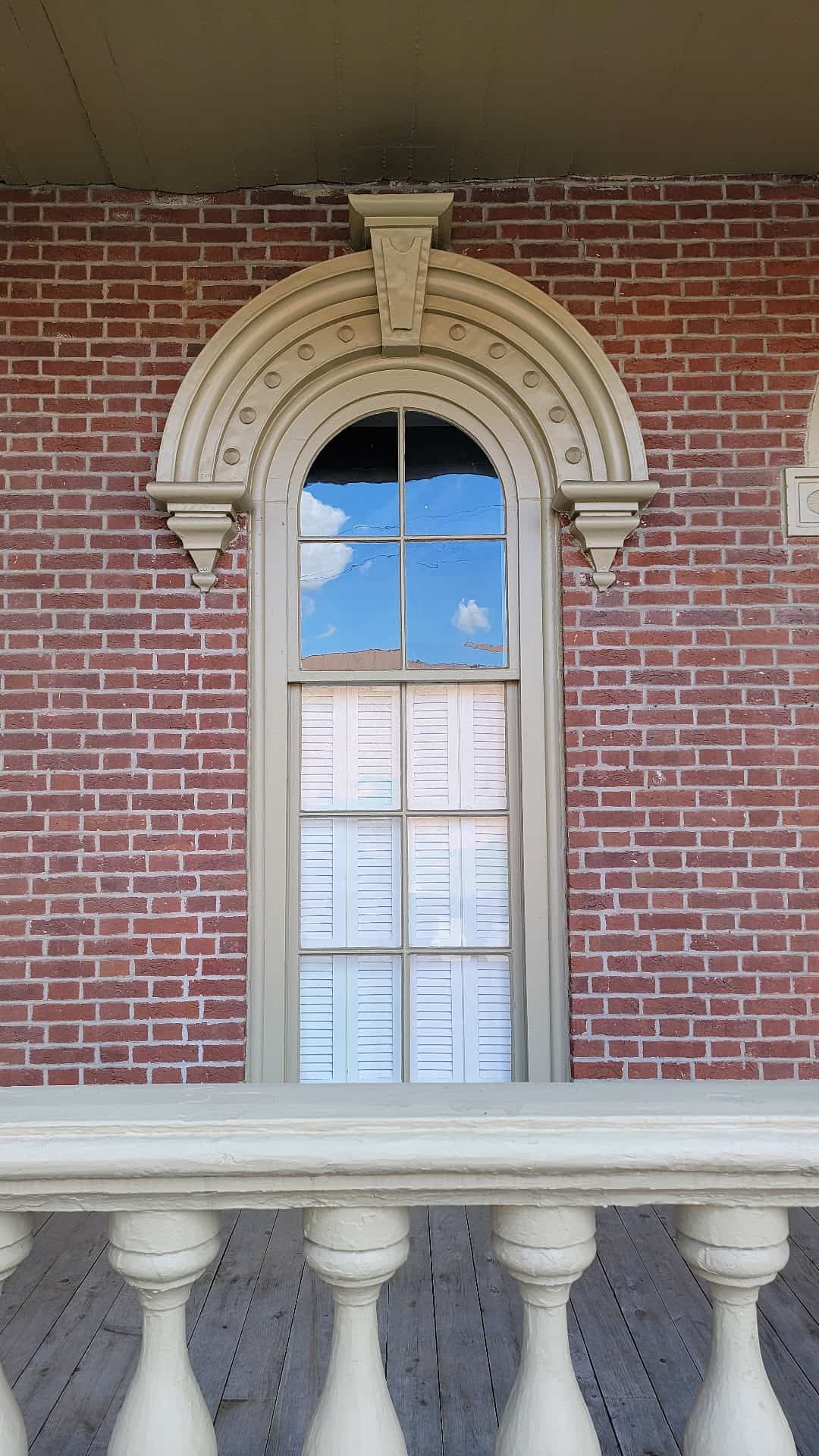 arched window on red brick building