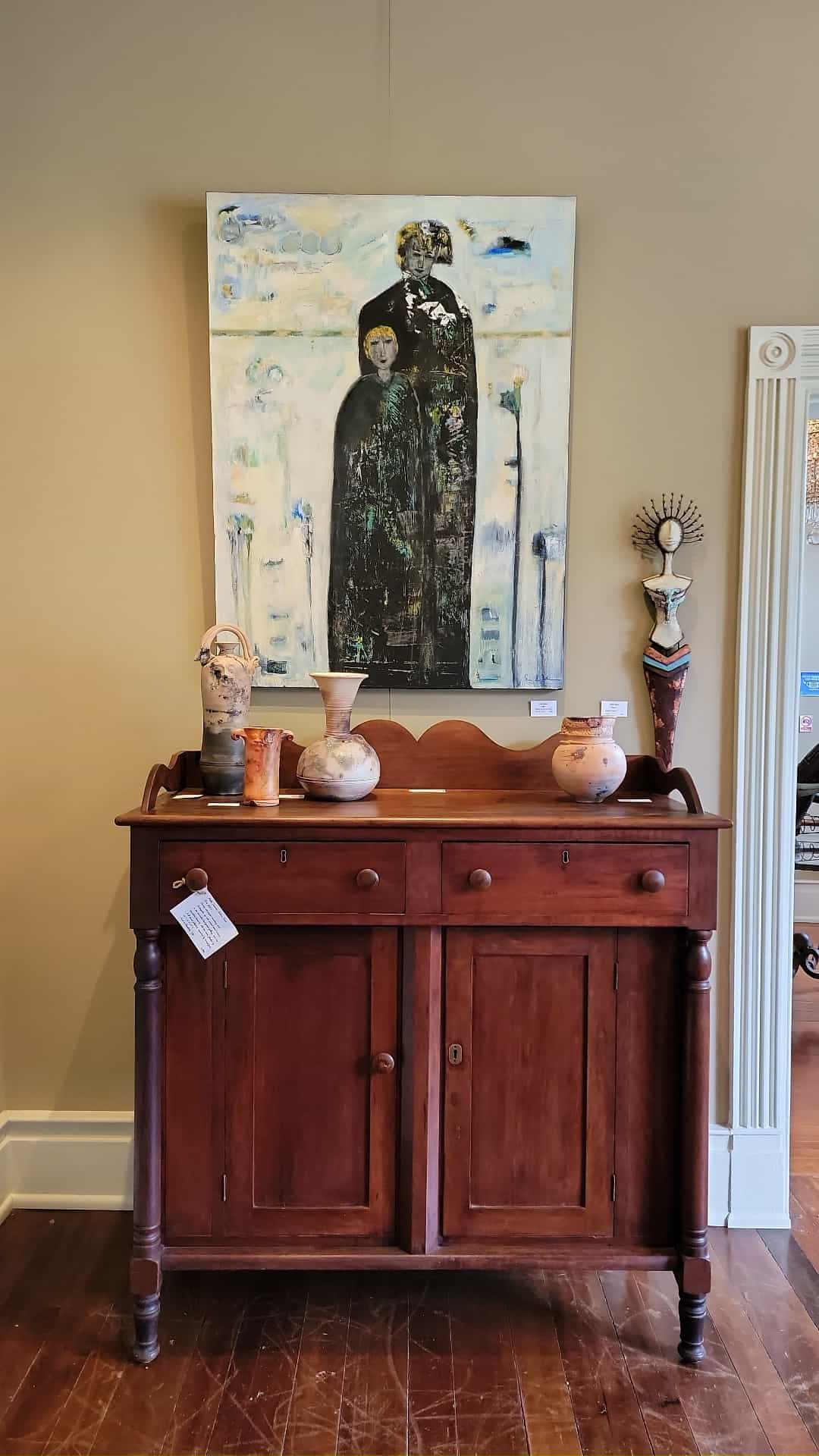 antique chest with art above it