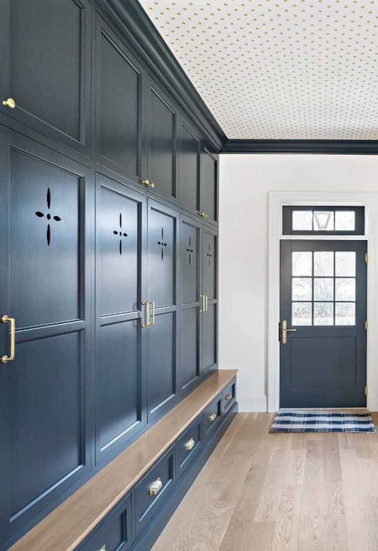 mudroom with dark cabinetry