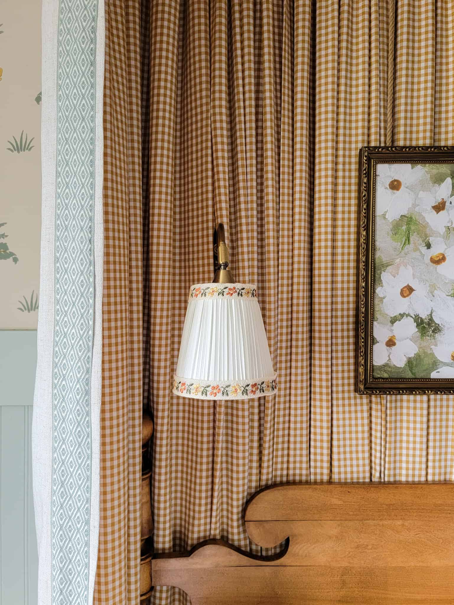 sconce with decorative trim on top of yellow gingham fabric