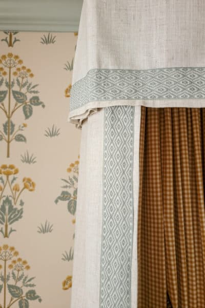 floral wallpaper background with bed canopy and decorative trim