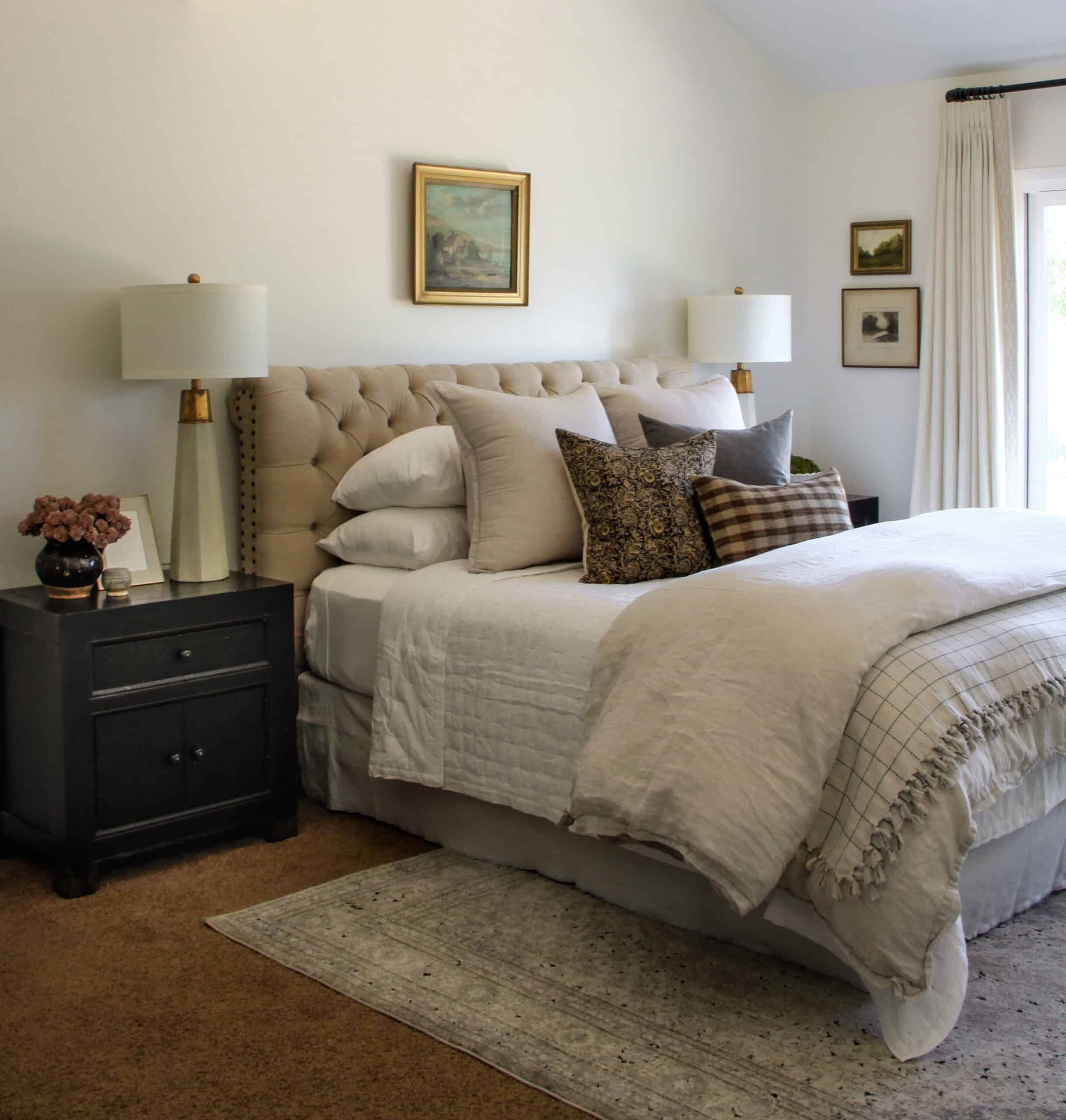 elegant master bedroom with oil painting over the bed