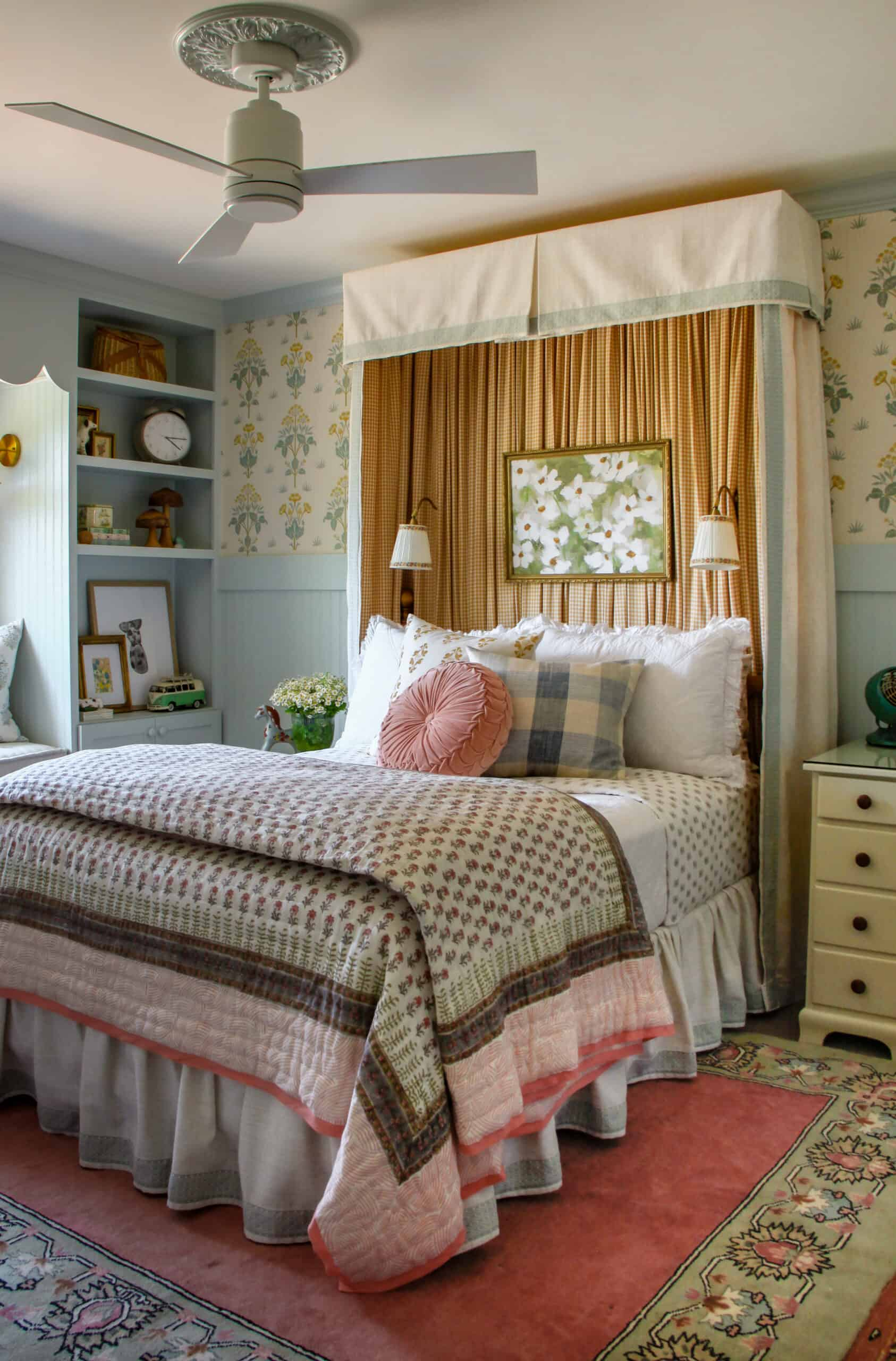 girl's bedroom with bed canopy and blue built in shelves