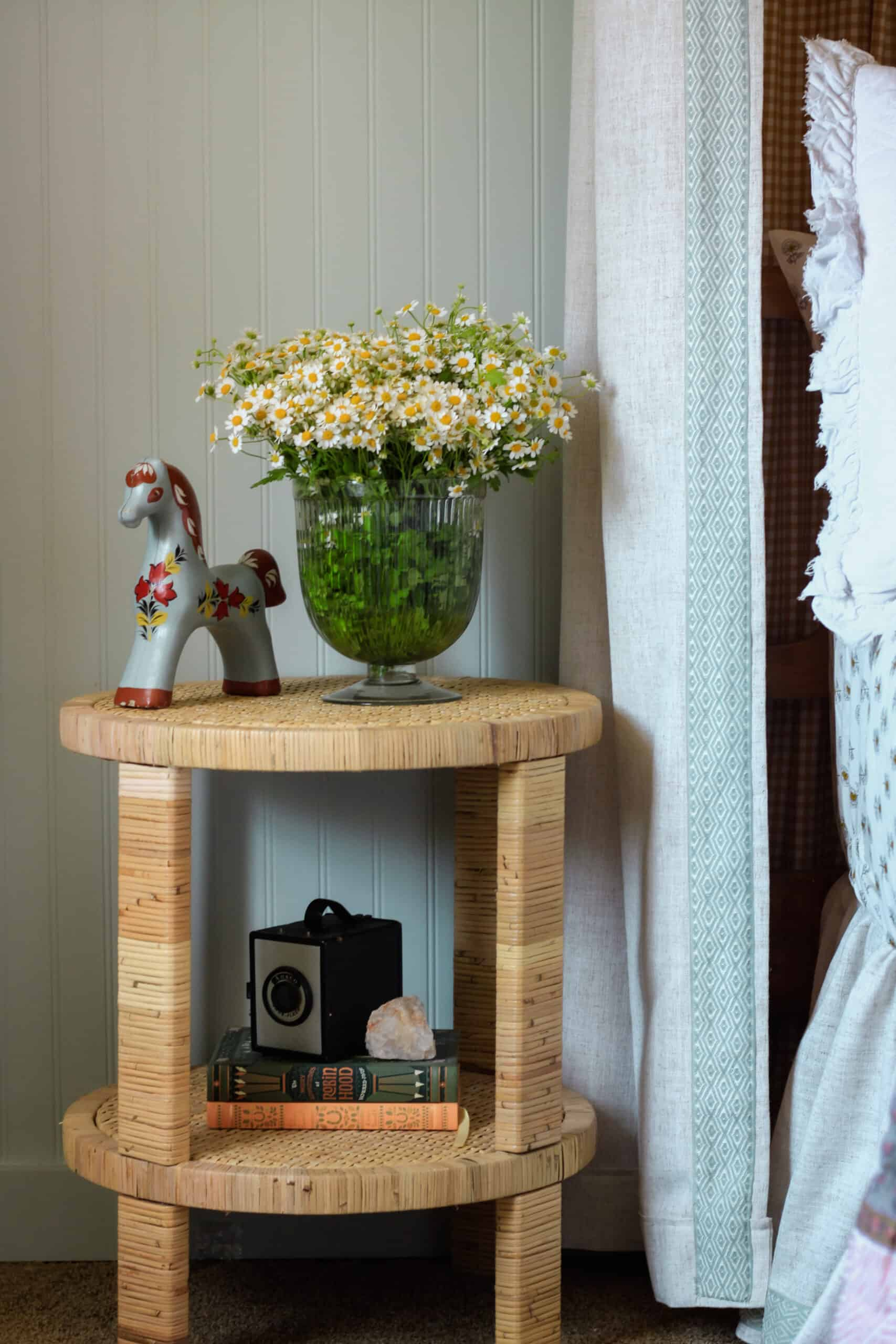 closeup of side table with daisies on it
