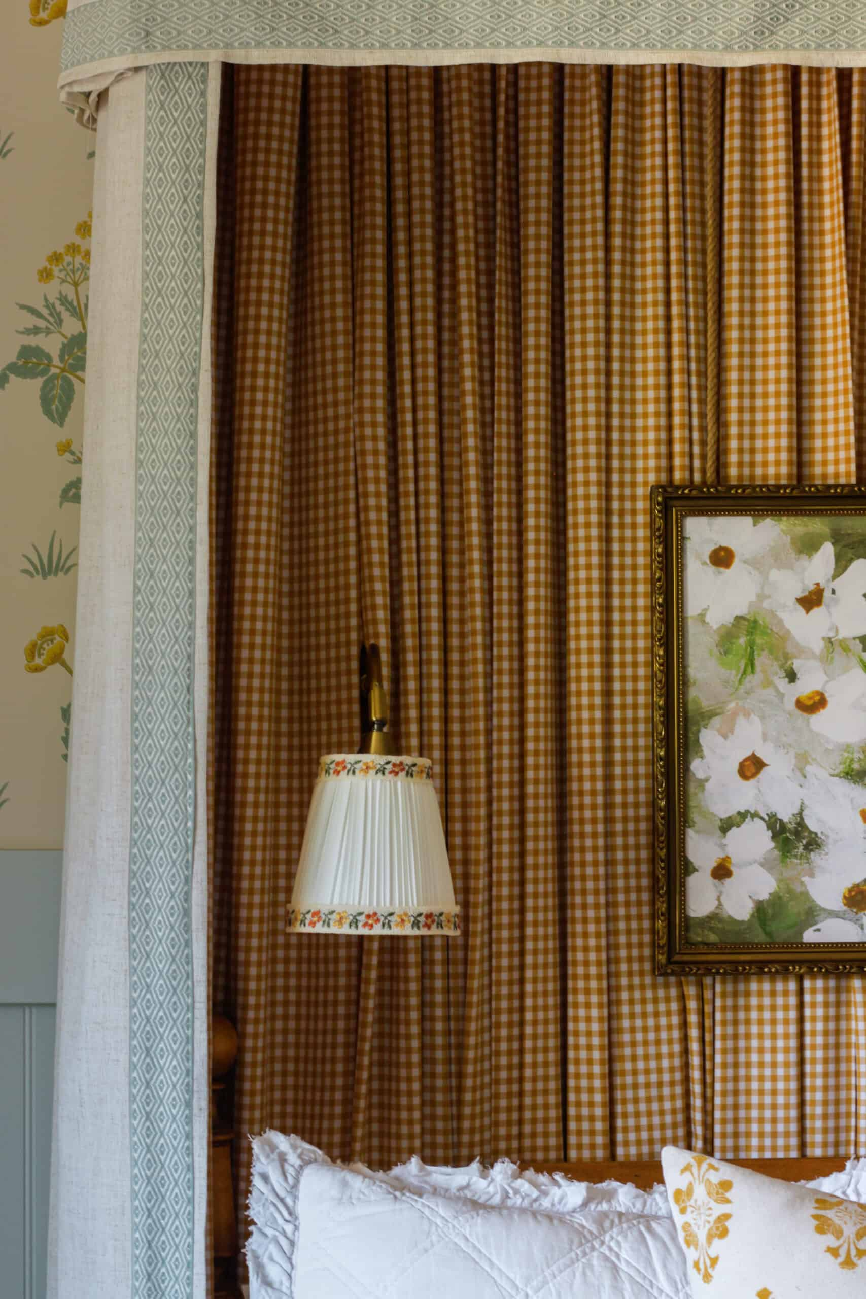 closeup of sconce with ribbon trim and wildflower painting