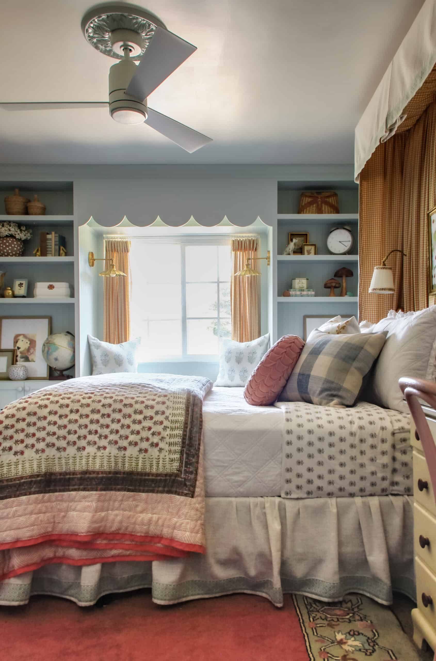 girl's bedroom with blue built ins and bed canopy