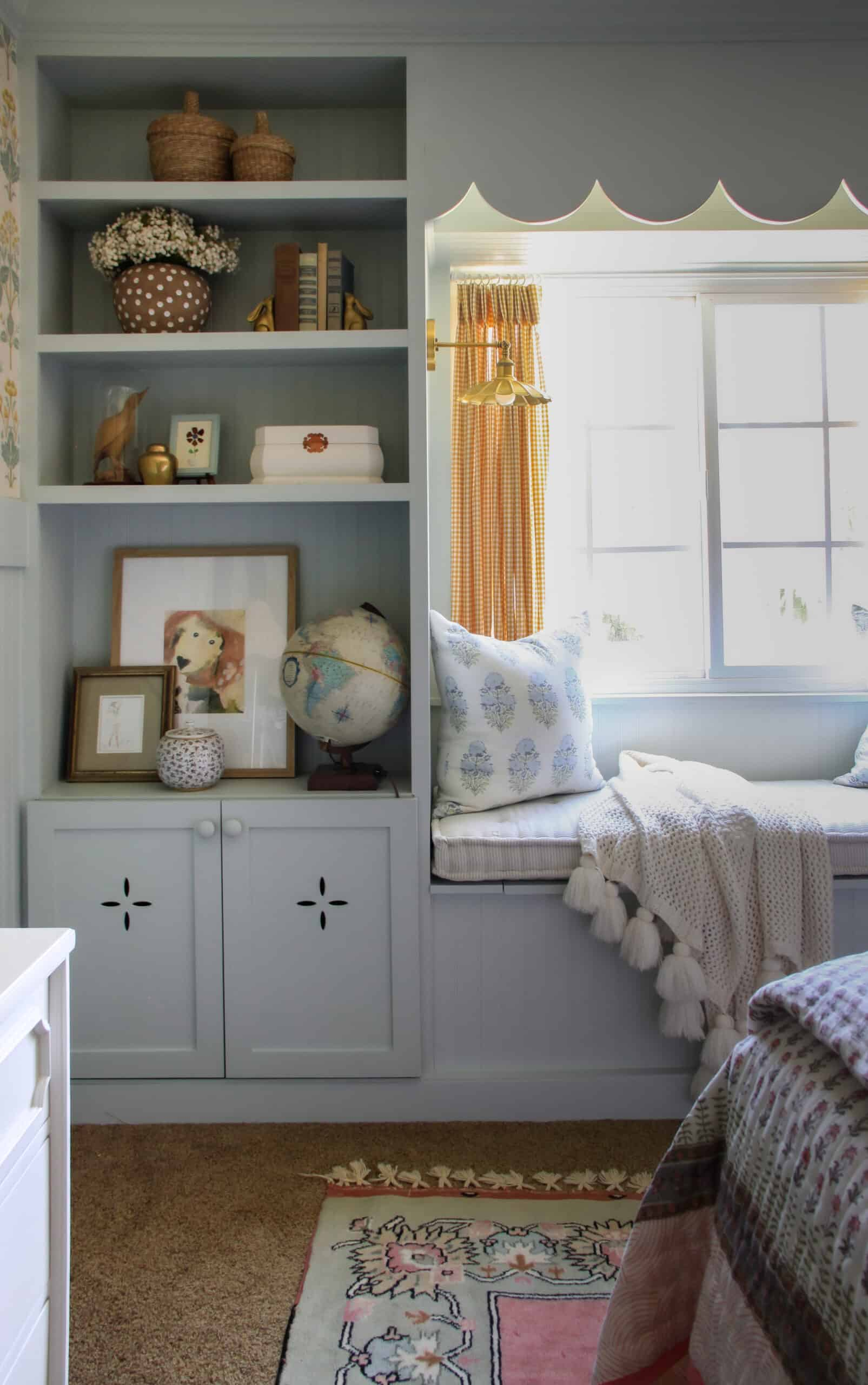 light blue built-in shelves with window seat