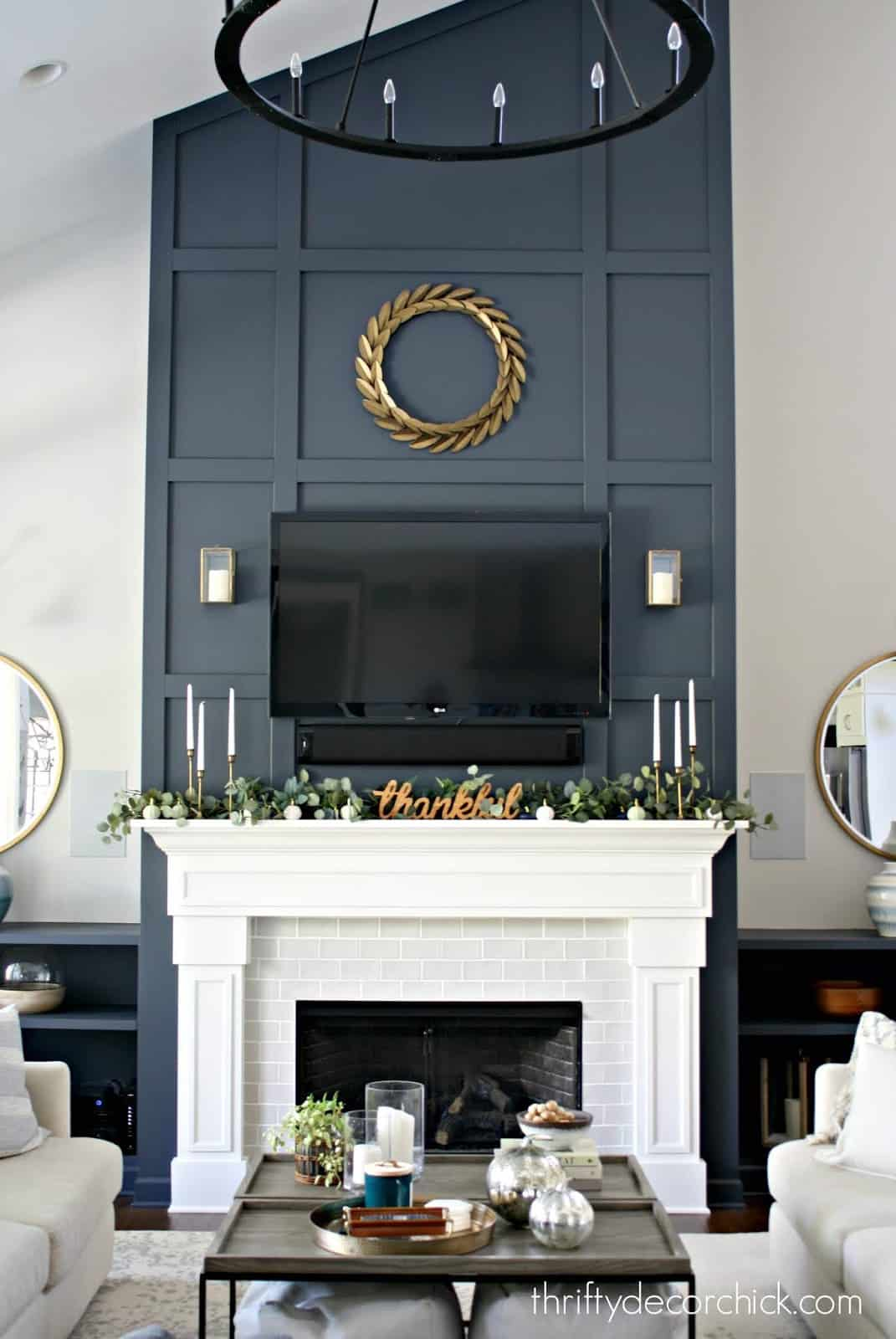 living room with large navy blue fireplace
