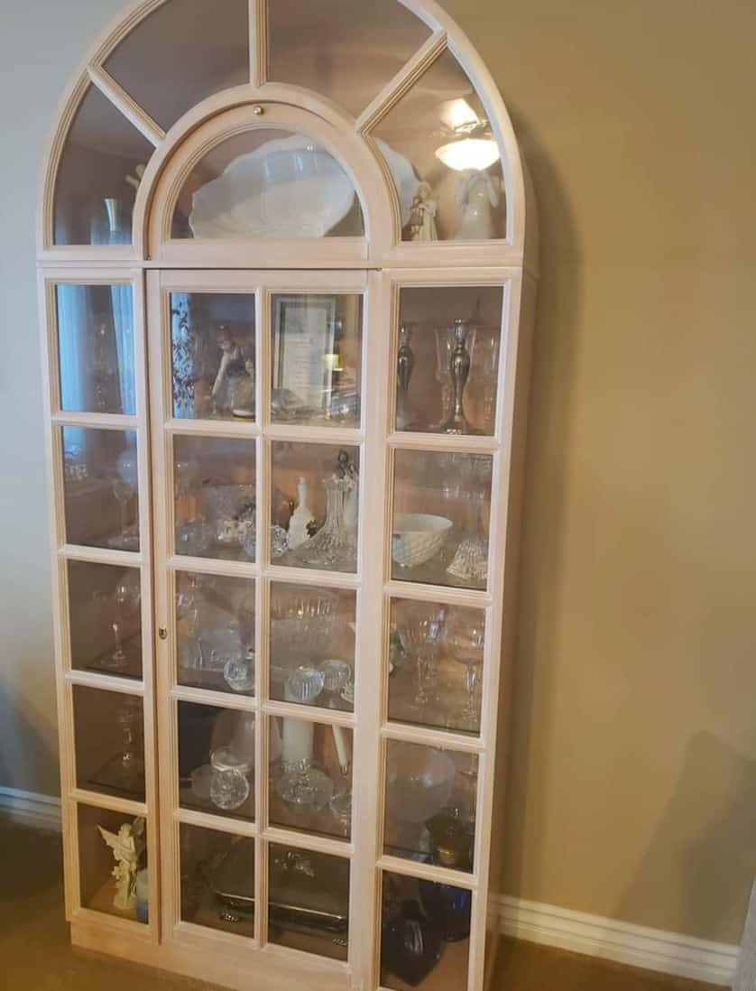 before picture of arched display cabinet