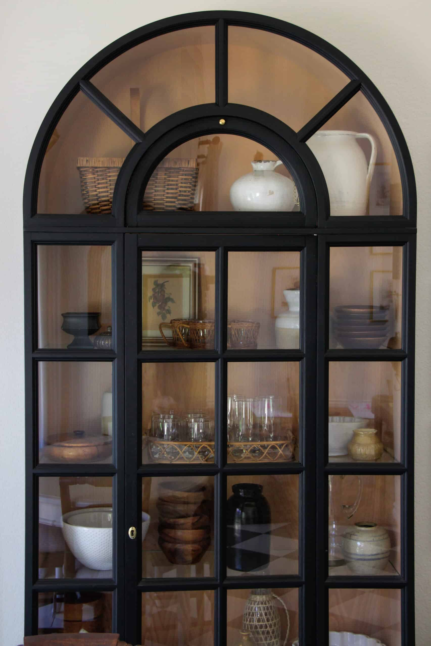 closeup of black arched display cabinet