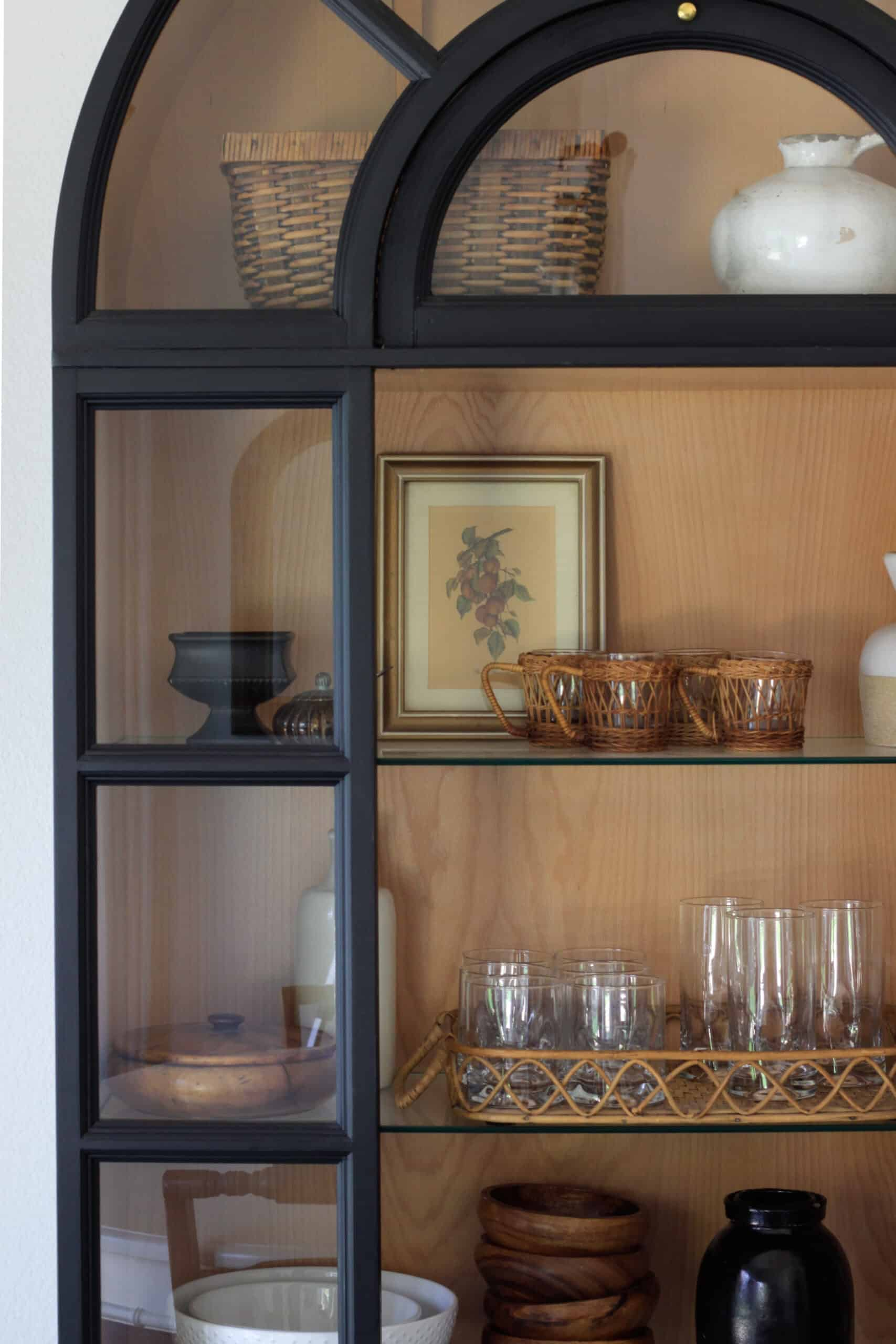shelves with styling pieces and glasses on them