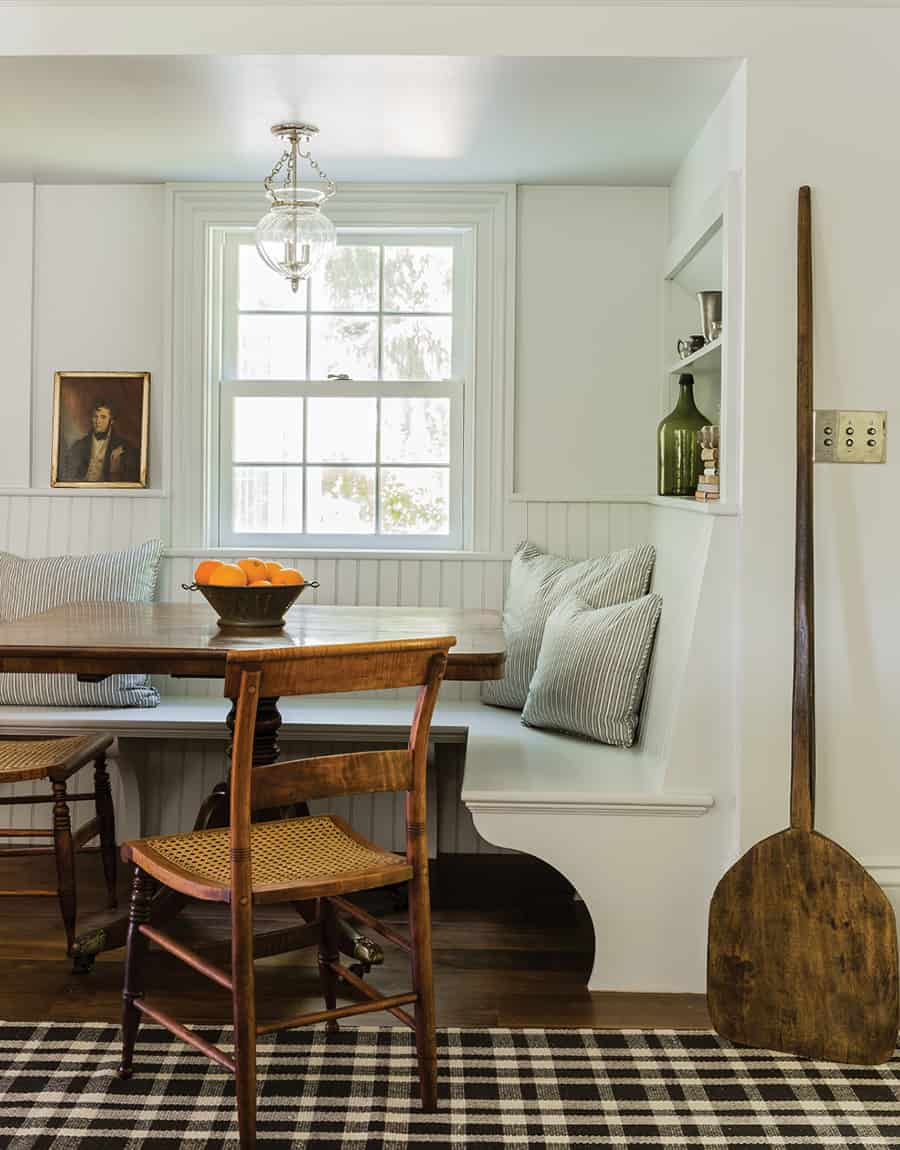 breakfast nook with banquette and vintage chairs