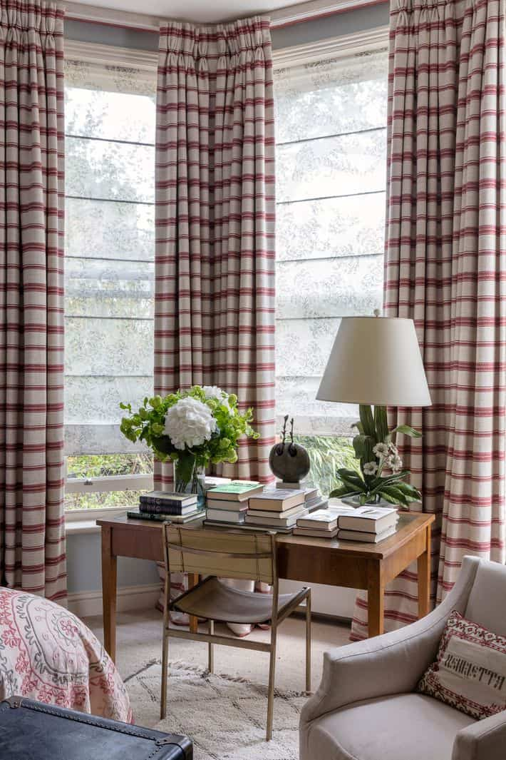 plaid curtains in bay window with desk