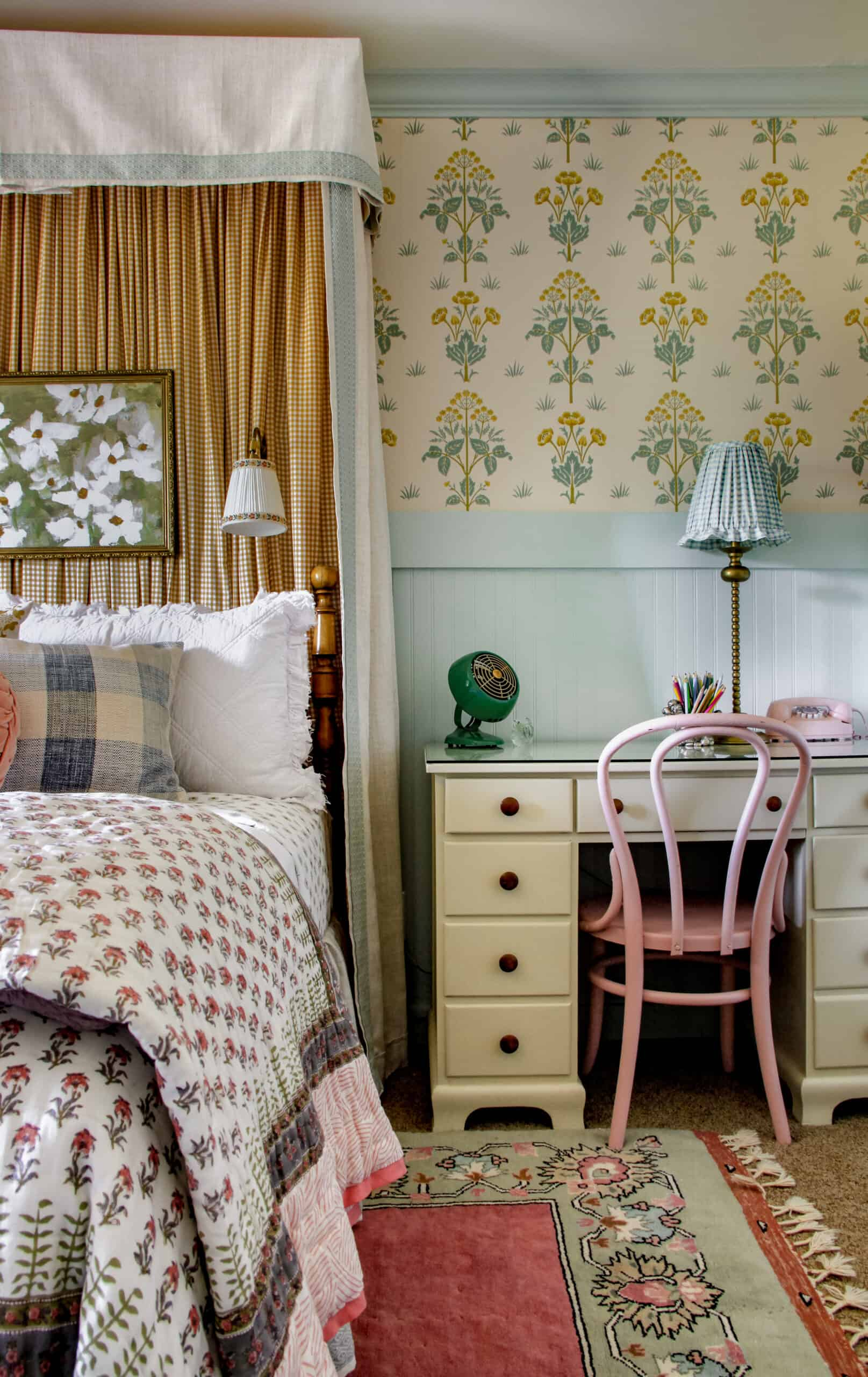 girl's bedroom with headboard canopy and desk beside bed