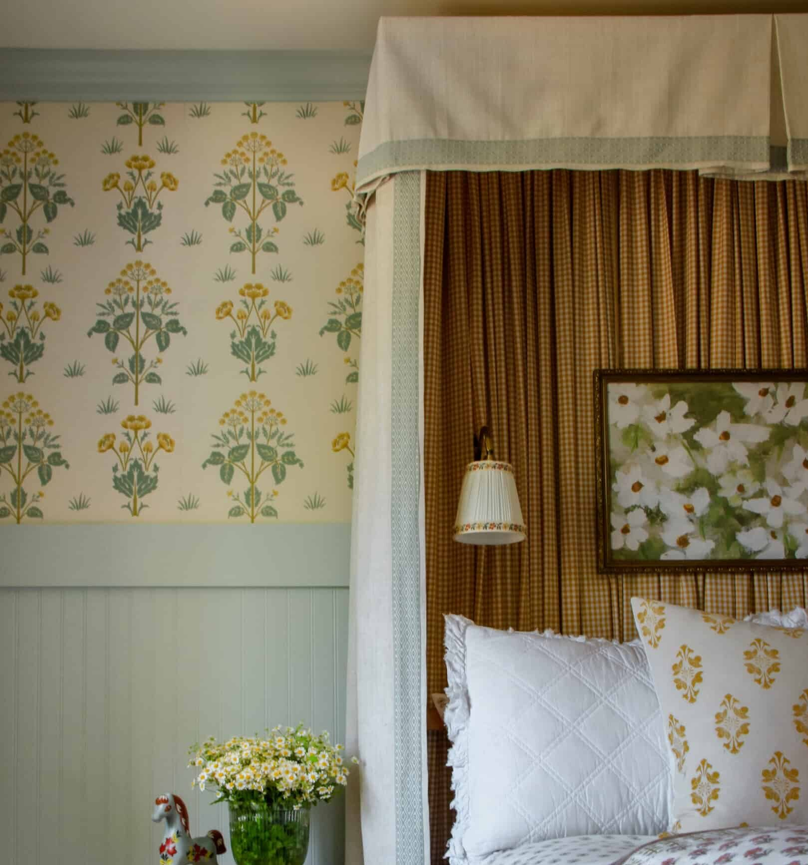 girl's bedroom with headboard canopy, wallpaper, and rattan side table