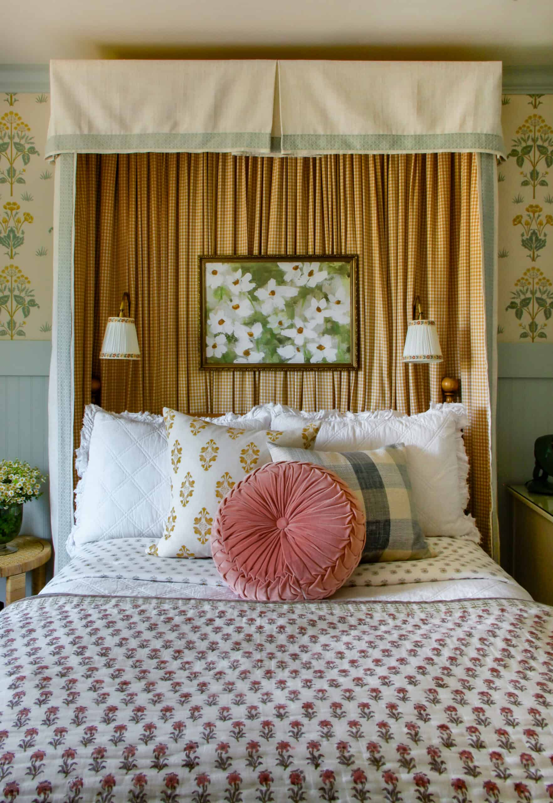 straight on photo of girl's bedroom with headboard canopy