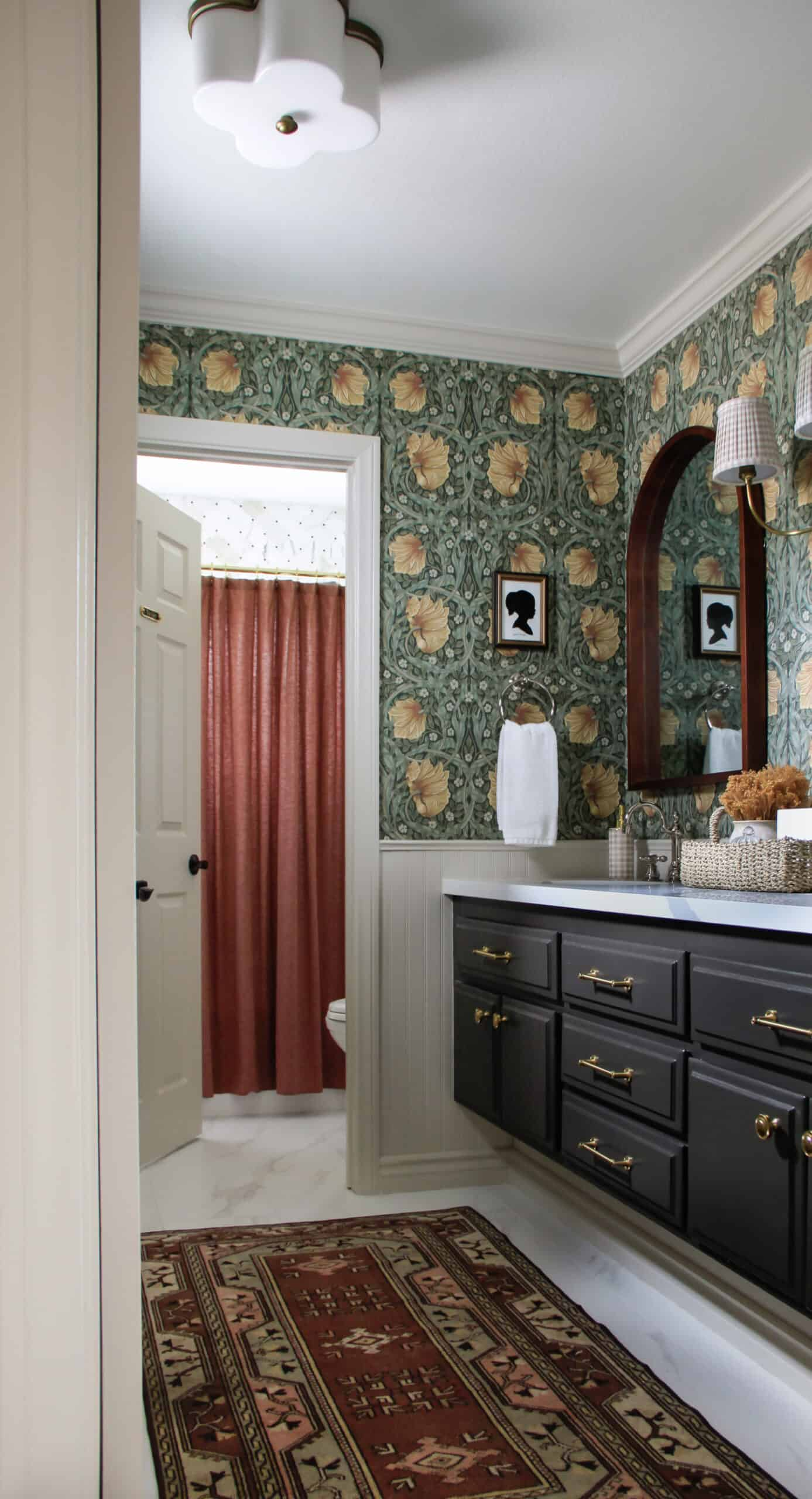 bathroom with wallpaper and vintage rug