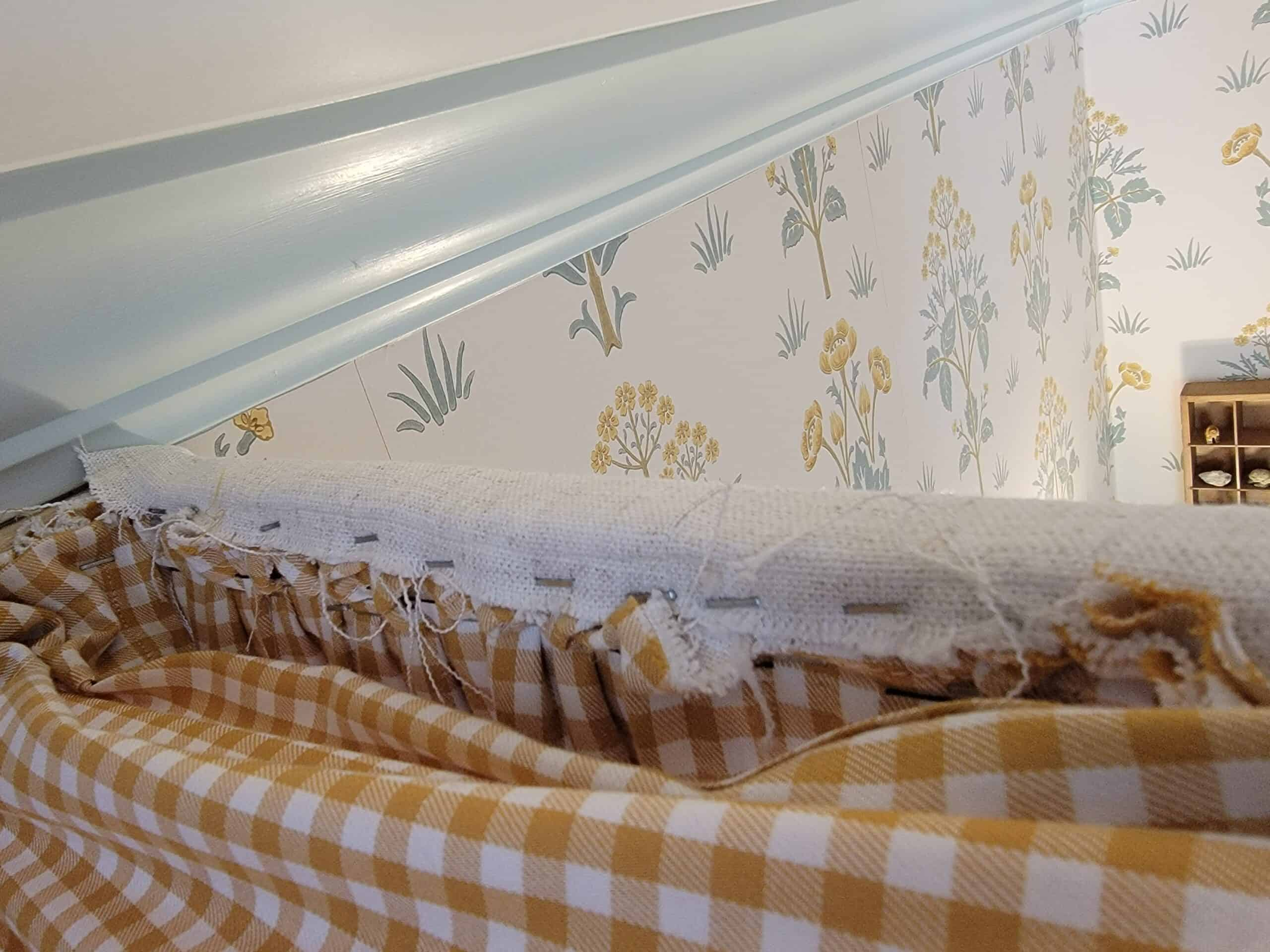 fabric stapled to the inside of headboard canopy