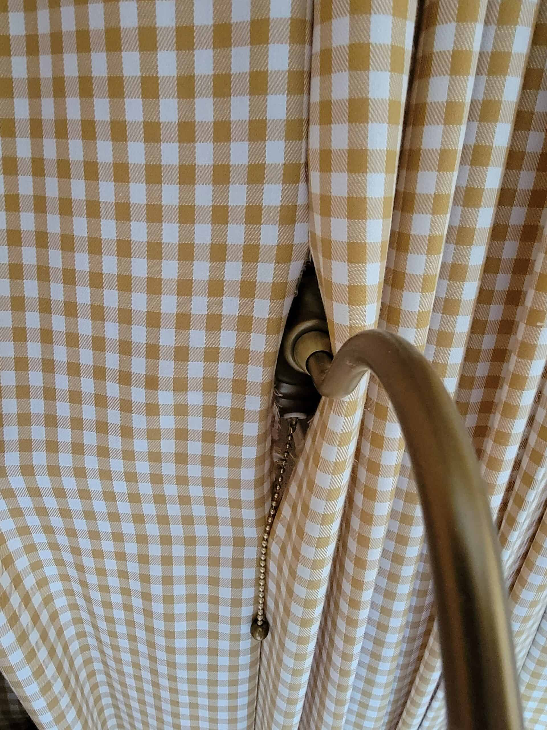 gingham fabric with a sconce peeking through