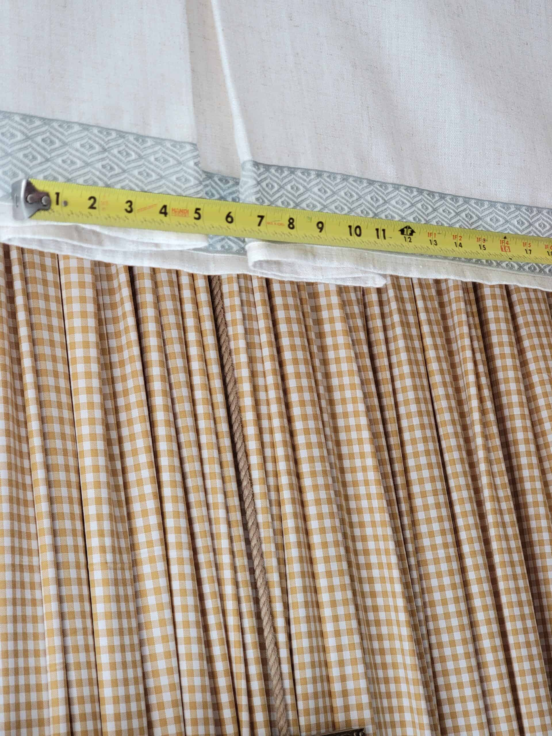 yellow tape measure against headboard canopy